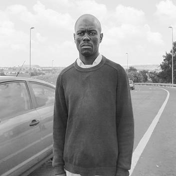 David Goldblatt, Ex-Offenders: Here, in 2005, Goodman Nhlanhla Hlope smashed a car window with a spark plug to steal a woman's handbag and cellphone. Maraisburg. , 18 February 2010