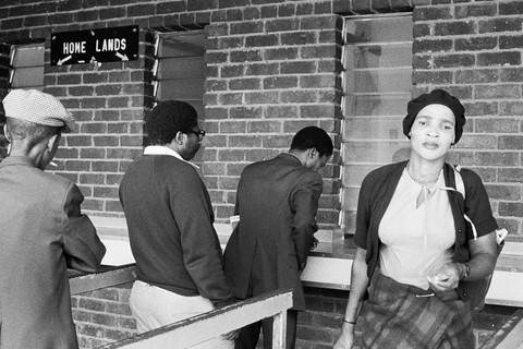 David Goldblatt, AM/PM. Travelers from KwaNdebele buying their weekly season tickets at the PUTCO depot in Pretoria, 1983