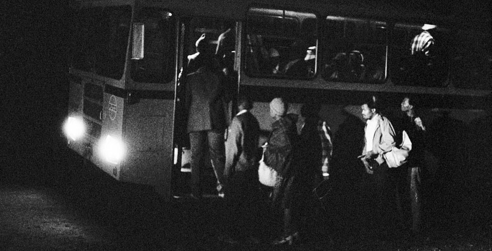 David Goldblatt, 2:45 am. Going to work: Boarding the first bus at Mathysloop. It should reach the terminal at Marabastad, in Pretoria, two and a half hours later, at 5:15 am, 1983
