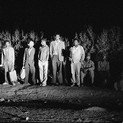 David Goldblatt, 2:40 AM GOING TO WORK: A line for the earliest bus forms near a resettlement camp in the bush of KwaNdebele on the Boekenhouthoek-Marabastad route. , 1984