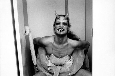 Peter Hujar, Man in Costume on Toilet, Backstage at Palm Casino Review, 1974
