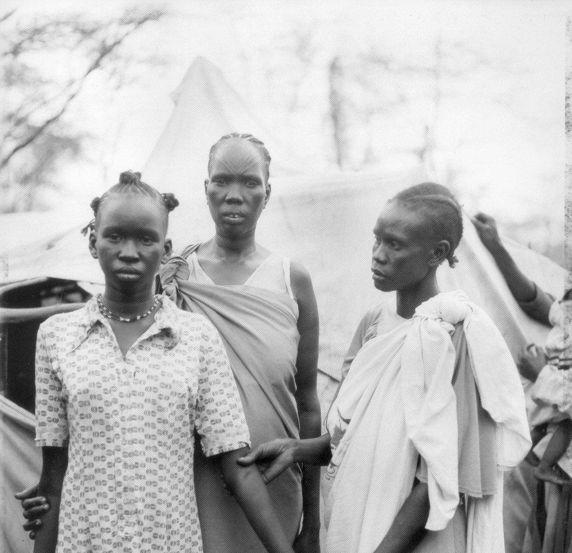 Fazal Sheikh, Akuot Nyibol (pregnant at center) with Riak Warabek and Akuot's daughter, Athok Duom, 1992