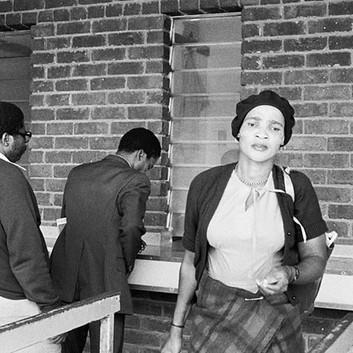 David Goldblatt, AM/PM: Travelers from KwaNdebele buying their weekly season tickets at the PUTCO depot in Pretoria. , 1983