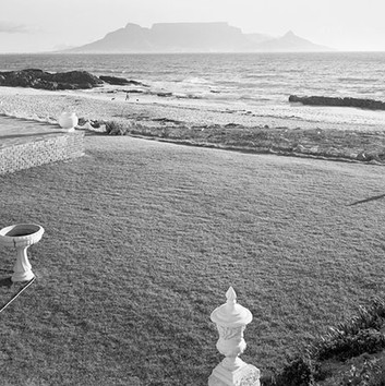 David Goldblatt, Suburban garden and Table Mountain. Bloubergstrand, Cape Town, Cape. , 9 January 1986