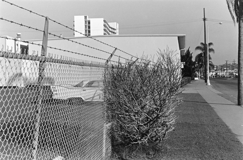 Lee Friedlander, San Diego (Car, Fence and Bush), California, 1970