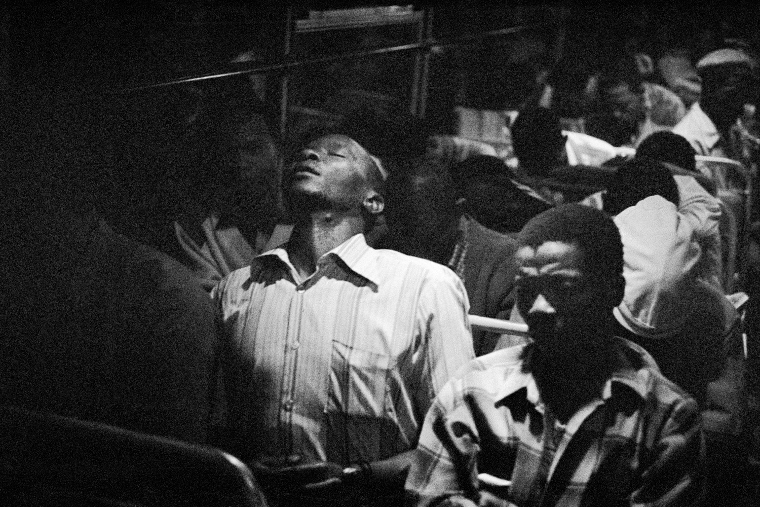David Goldblatt, 9:00 pm. Going home: Marabastad-Waterval bus: For most of the people in this bus the cycle will start again tomorrow at between 2:00 and 3:00 am, 1983