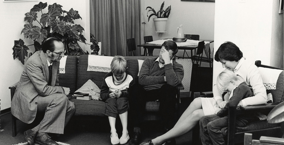 David Goldblatt, Dominee S M van Vuuren of the Dutch Reformed Church, Whitfield, at prayer with a family during a pastoral call, Boksburg, 17 June 1980