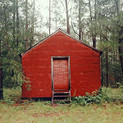 William Christenberry, Red Building in forest, Hale County, Alabama, 1983