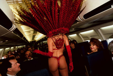 Lauren Greenfield, A show girl models fashions on an airplane, Las Vegas, Nevada, 1995