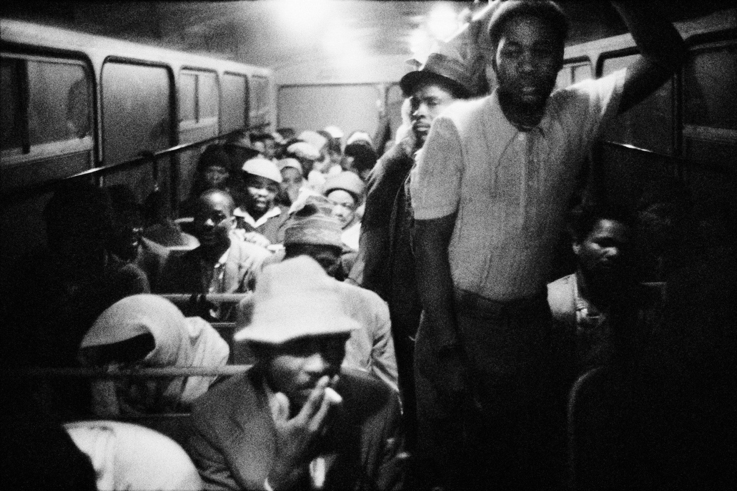 David Goldblatt, 3:15 am. Going to work: The Wolwekraal - Marabastad bus is licensed to carry 62 sitting and 29 standing passengers, 1983