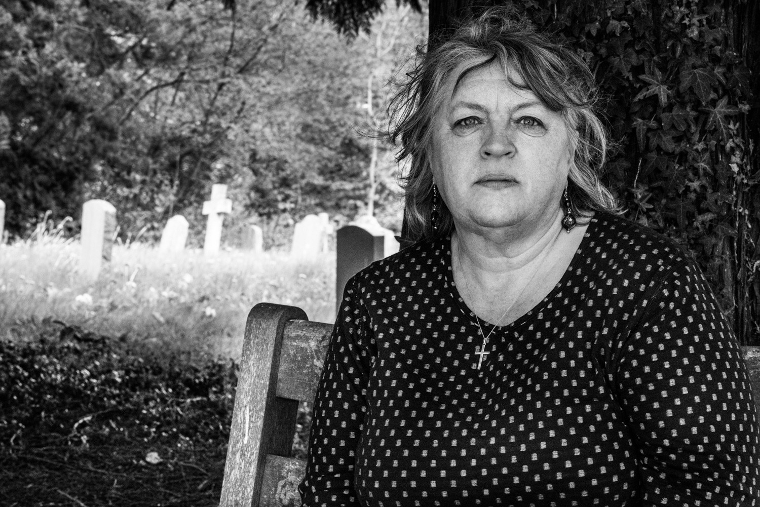 David Goldblatt, Lucy Charman at the village cemetery where her grandparents, father and uncle are buried. Haslemere, Surrey, 9 May 2015