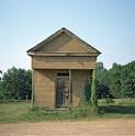William Christenberry, Building with False Brick Siding, Warsaw, Alabama, 1974