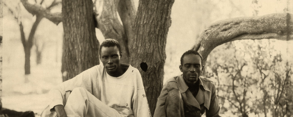 "Fazal Sheikh, Miriam Mac and Agot Anyang playing ""bao"", Family section, Sudanese refugee camp, Kakuma, Kenya, 1992"