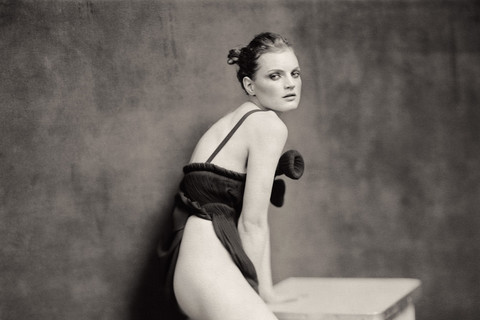 Paolo Roversi, Guinevere leaning on a table, Paris, 2004