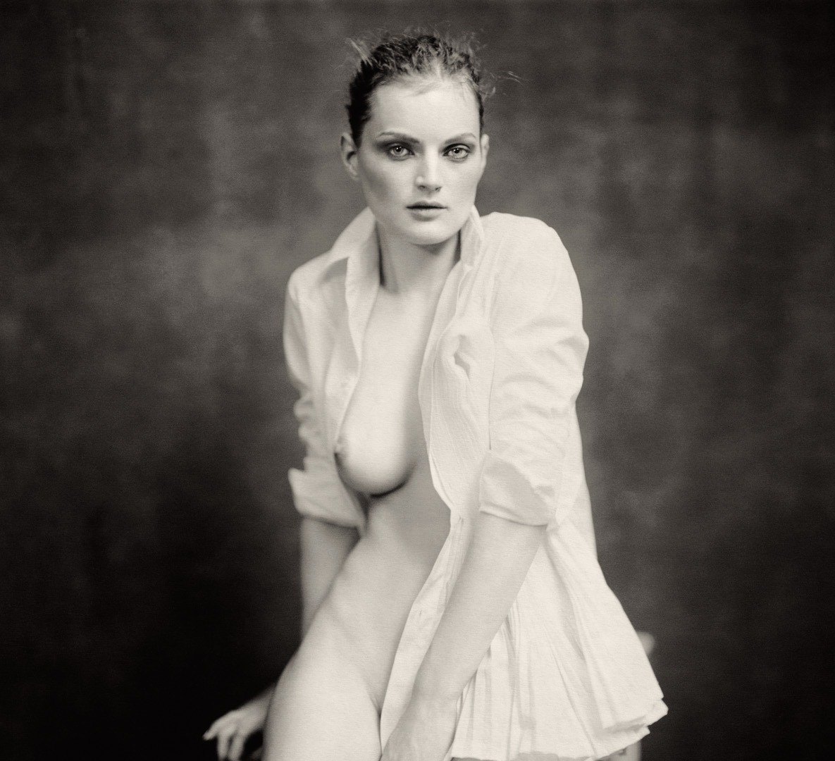 Paolo Roversi, Guinevere sitting on table, Paris, 2004