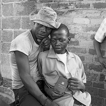"David Goldblatt, Young men with a ""pass"" book. Any black person without a valid pass in his possession was liable to summary arrest. White City, Jabavu, Soweto. , 1972"