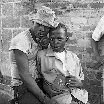 """David Goldblatt, Young men with a """"pass"""" book. Any black person without a valid pass in his possession was liable to summary arrest. White City, Jabavu, Soweto. , 1972"""