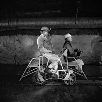 David Goldblatt, Team leader and mine captain on a pedal car, Rustenburg Platinum Mine, Rustenburg. , 1971