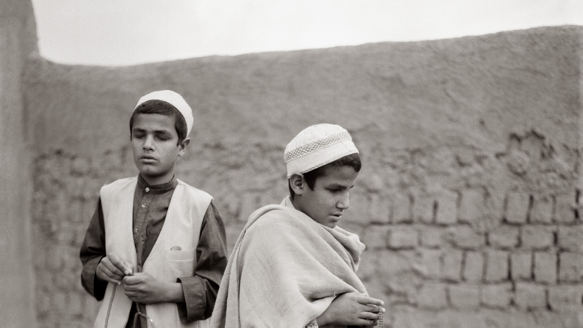 "Fazal Sheikh, Osman and Farid, blind ""qari"" brothers with rosaries, Afghan refugee village, Nasirbagh, Northwestern Frontier Province, Pakistan, 1997"