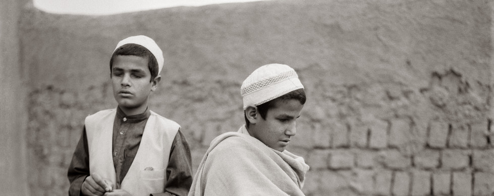 """Fazal Sheikh, Osman and Farid, blind """"qari"""" brothers with rosaries, Afghan refugee village, Nasirbagh, Northwestern Frontier Province, Pakistan, 1997"""