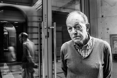 David Goldblatt, Eric Allison at the side entrance to the former bank to which he and his friends had secret access for six months. Manchester, 4 May 2015