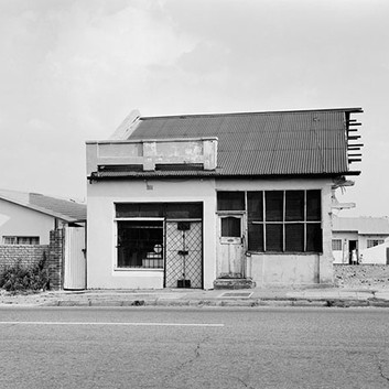 David Goldblatt, Hassimia Sahib's butchery still in business after the destruction of part of the building under the Group Areas Act. Pageview, Johannesburg, Transvaal. , 8 March 1986