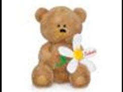 Медвежонок с большой ромашкой муз.(21см)