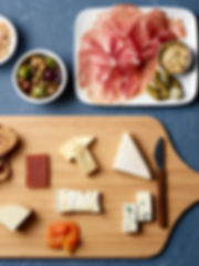 Marcona Almonds with sea salt. Marinated Olives with lemon, thyme. Charcuterie Board with cornichons, mustard, baguette, prosciutto, bresaola, salame. Cheese Board with quince paste, honey, apricot, toast robiola, point reyes blue, Humboldt fog, gouda, and petit basque