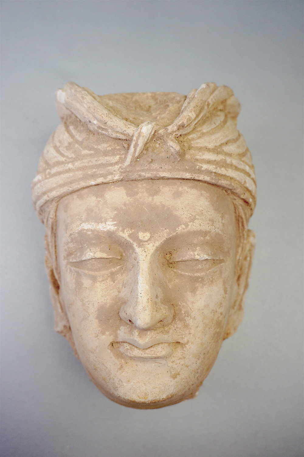 Gandhara Stucco Head of a Buddhisattva, purchased in Kashmir in 1969.