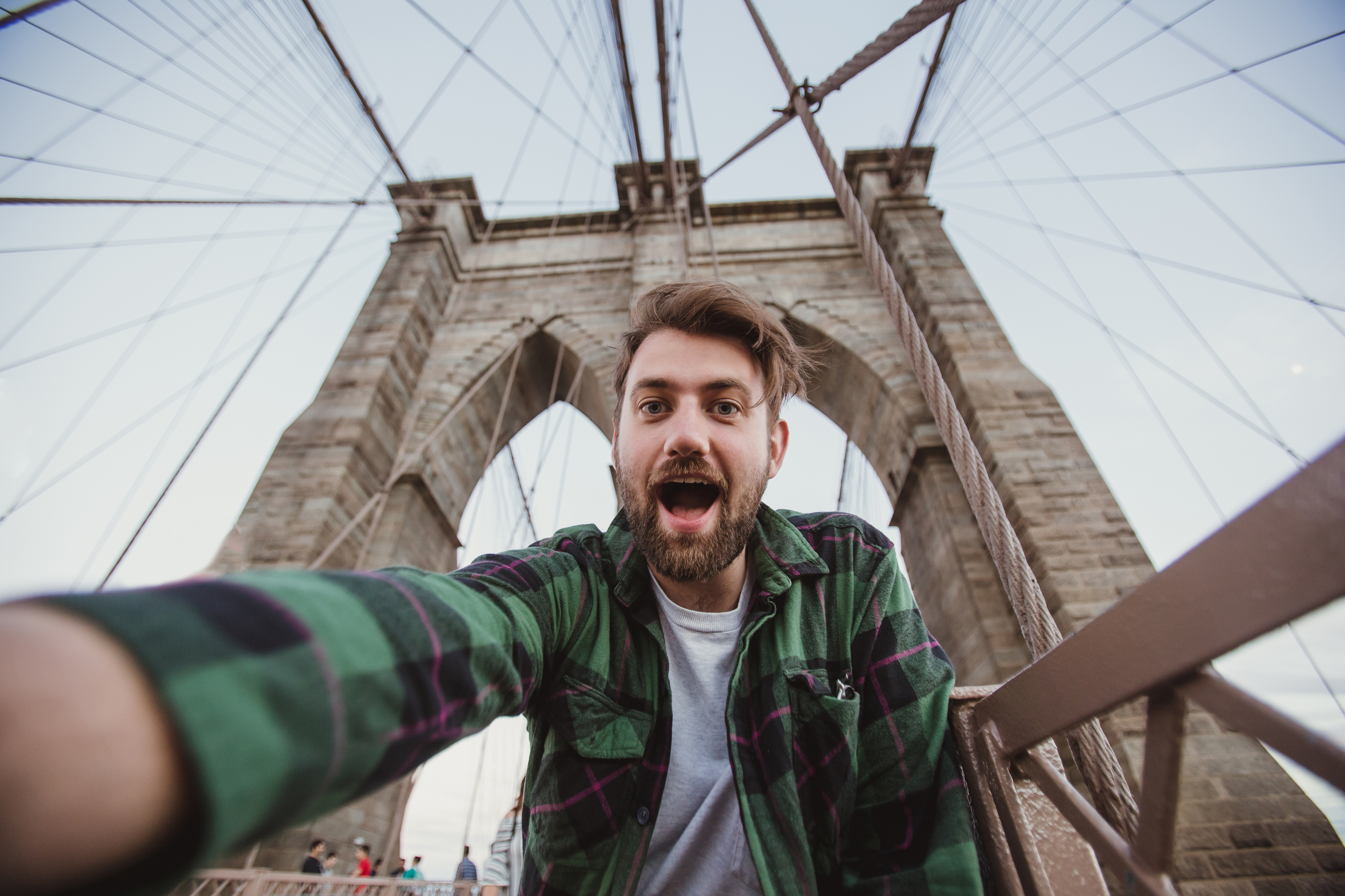Handsome hipster guy taking selfie self-portrait on Brooklyn Bridge, New York.jpg Cute bearded stude