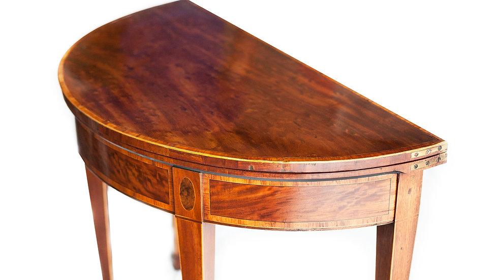 A beautiful 'plum pudding' mahogany card table