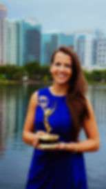 Woman holding Emmy award in downtown Orlando
