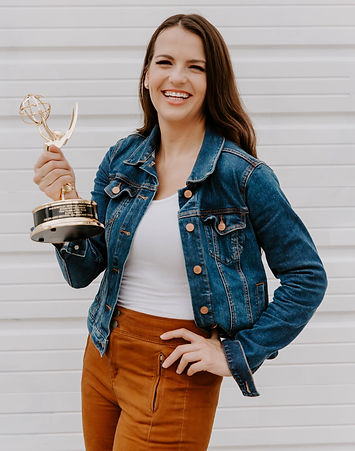 Kayla O'Brien holding an Emmy