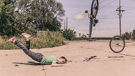 Man falling off a bicycle