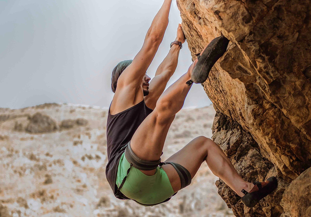 Mountaineer climbing a rock - What's your biggest marketing challenge?