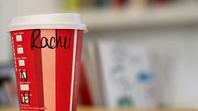 A takeaway cup with a hand written name on it