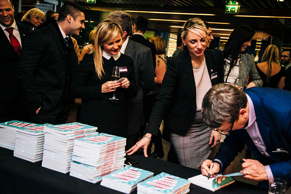Craig Thatcher signing copy of Continuous Branding book