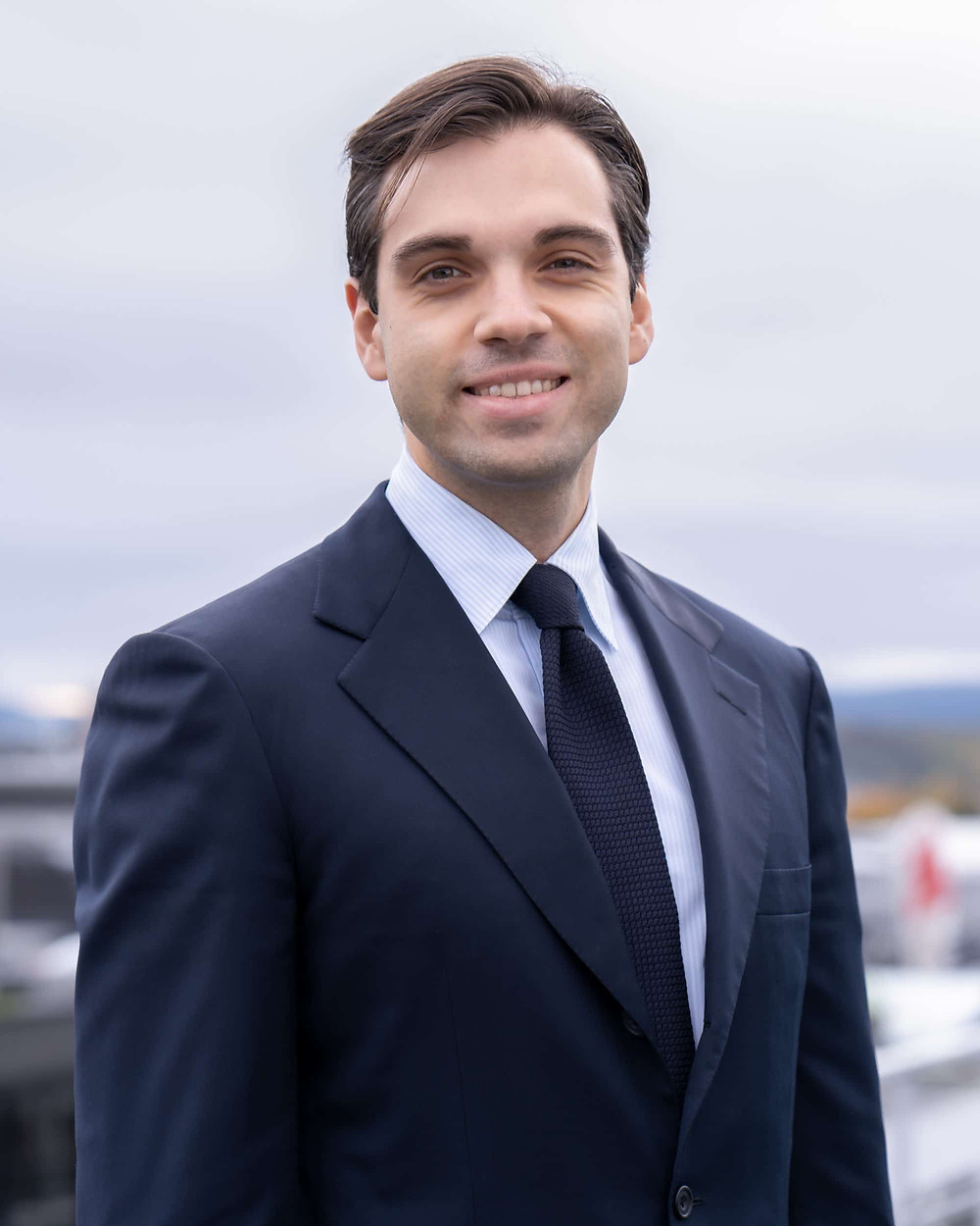 headshot of a man in a suit