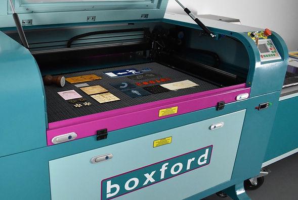 Boxford C02 laser cutting machine showingrange of items machine can produce
