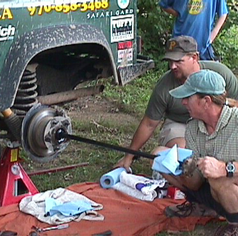 Bill Burke shows the crowd on how to change a broken axle