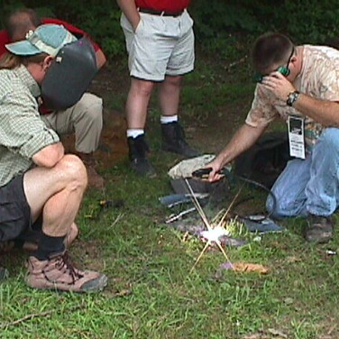 """Bill Burke is giving Alan a quick training for trail-welding with the under hood """"Premier Power Welder"""""""