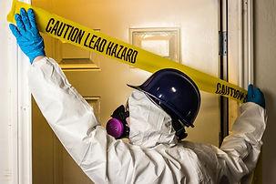 Environmental abatement worker hangs lea