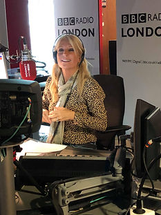Gaby Roslin wearing Manchester bee scarf