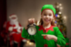Happy child in Christmas elf costume wit