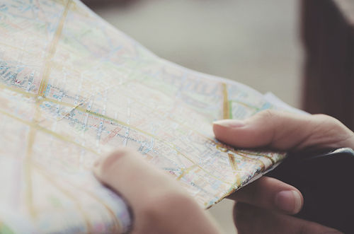 Hands Holding a Map