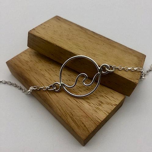 Bracelet médaillon vague ajourée en argent