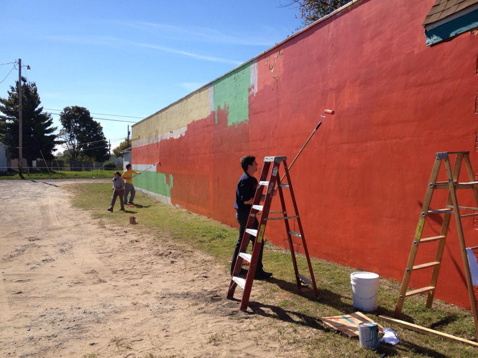The community came together to re-paint blighted buildings along Western Avenue. Source: South Bend Better Block Facebook page