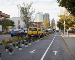 Citizen lead Better Block in Kansas City prototyped a Grander Grand Ave with cycle tracks. Traffic? Not a problem they reported.