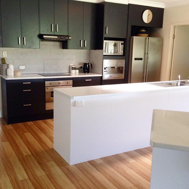 New look sleek black and white kitchen
