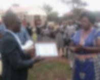 Priscilla receiving certificate on behal